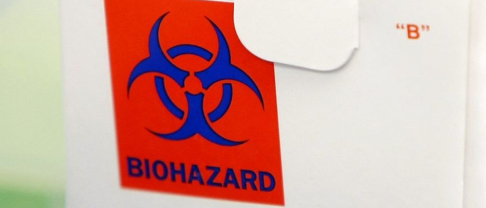 A biohazard sign on a sample box is seen at the County of San Diego Health and Services Agency in San Diego