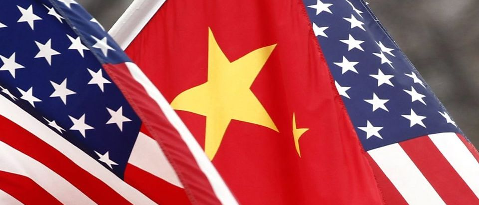 Chinese and U.S. flags fly along Pennsylvania Avenue outside the White House in Washington