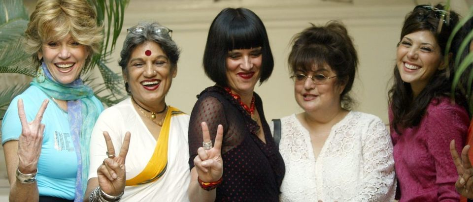 "Jane Fonda (L) and Marisa Tomei (R) along with American author Eve Ensler (C) and Indian theatre personalities Dolly Thakore (2L) and Mahabanoo Mody (2R) gesture during a photocall in Bombay March 8, 2004. The Hollywood stars are in Bombay for a special viewing of Ensler's controversial play ""The Vagina Monologues"". REUTERS/Sherwin Crasto"