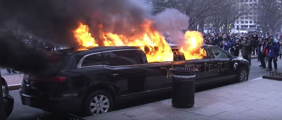 Riots Set a Limo Ablaze