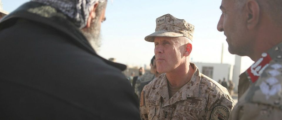 Handout of Vice Admiral Robert S. Harward, commanding officer of Combined Joint Interagency Task Force 435, greets an Afghan official during his visit to Zaranj