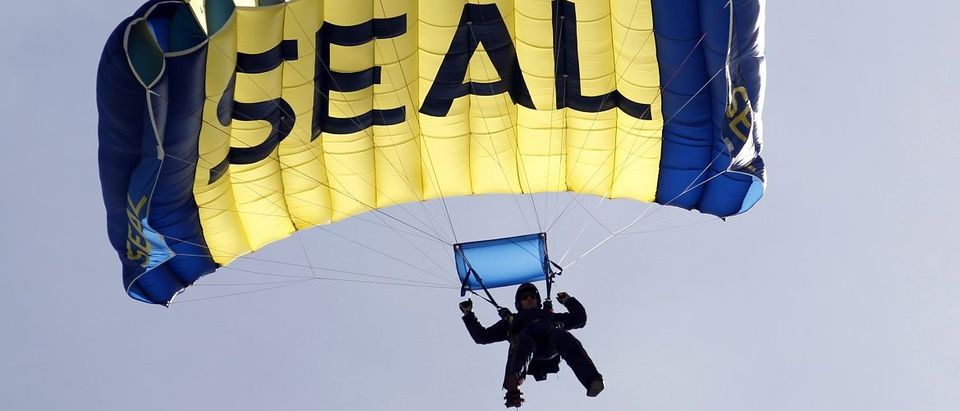 A U.S. Navy SEAL takes part in a demonstration of combat skills at the National Navy UDT-SEAL Museum in Fort Pierce