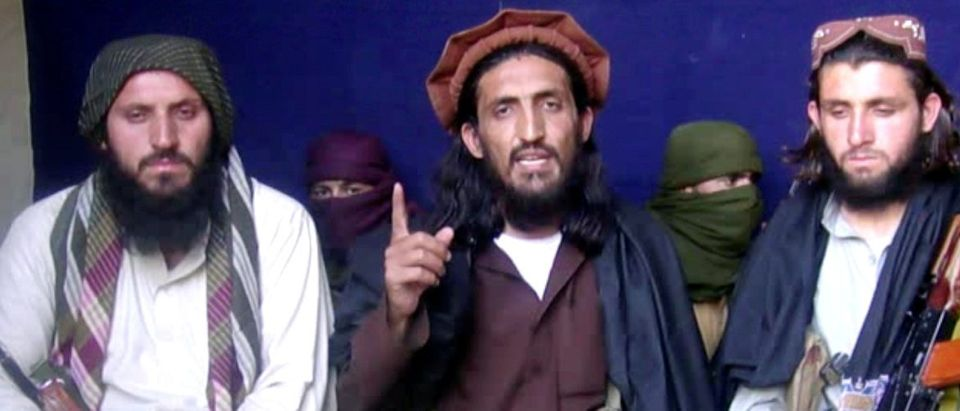 In this file image taken from a video recording, Pakistan Taliban commander, gives an interview in Pakistan's Mohmand tribal region