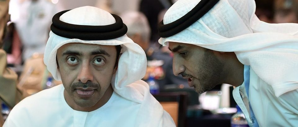 "UAE Foreign Minister Sheikh Abdullah bin Zayed Al-Nahyan listens to his personal assistant during the IISS Regional Security Summit ""The Manama Dialogue"" in Manama"