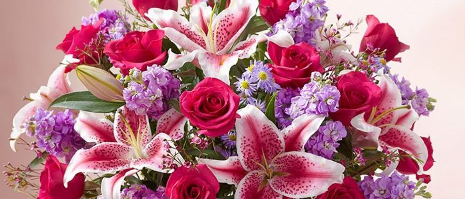 You will be sure to 'wow her' with arrangements from 1800flowers.com this Valentine's Day (Photo via 1800flowers.com)