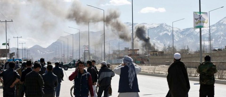 Smoke rises from the site of a blast and gunfire between Taliban and Afghan forces in PD 6 in Kabul, Afghanistan
