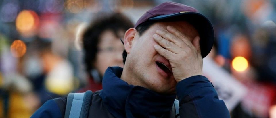 A man cries at a rally celebrating the impeachment of South Korea's ousted leader Park Geun-hye in Seoul