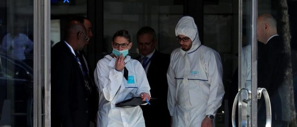 Members of the scientific Police leave the International Monetary Fund (IMF) offices where an envelope exploded in Paris