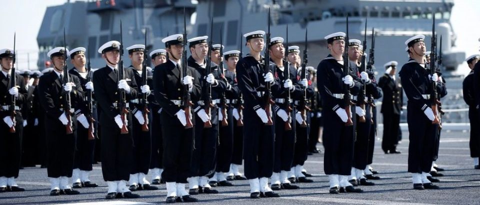Members of the JMSDF attend a handover ceremony for the JMSDF latest helicopter carrier DDH-184 Kaga by Japan Marine United Corporation in Yokohama