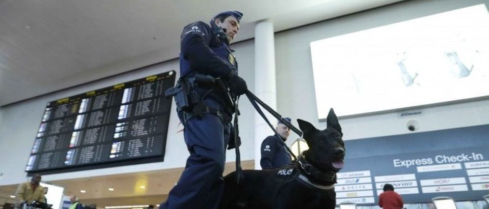 Policemen patrol in the Zaventem airport prior to a ceremony commemorating the first anniversary of twin attacks at Brussels airport and a metro train in Brussels