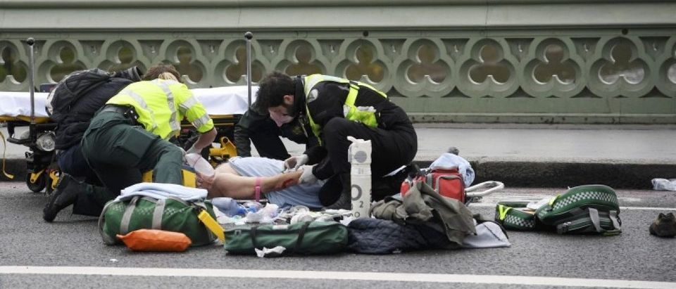 Paramedics treat an inured person after an incident on Westminster Bridge in London