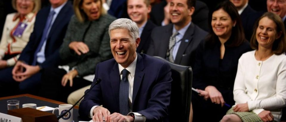 """Gorsuch and his supporters seated behind him erupt in laughter after he accidentally used the word """"bigly"""" during the third day of his Senate Judiciary Committee confirmation hearing on Capitol Hill in Washington"""