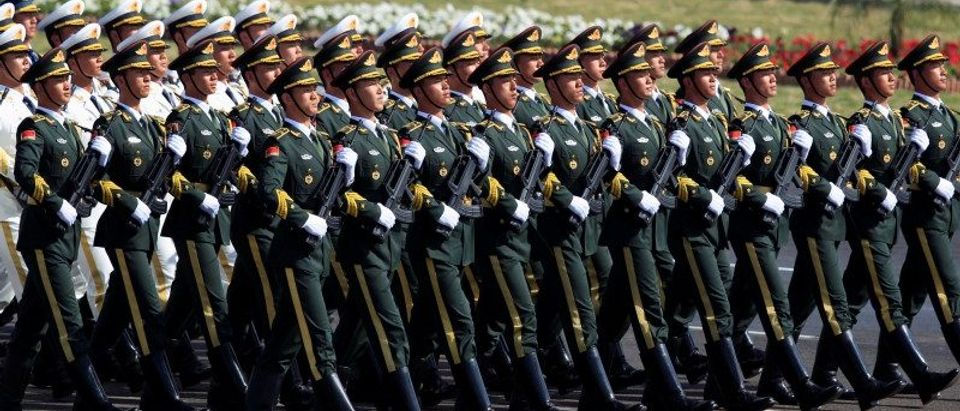 Chinese troops march as they take part in Pakistan Day military parade in Islamabad