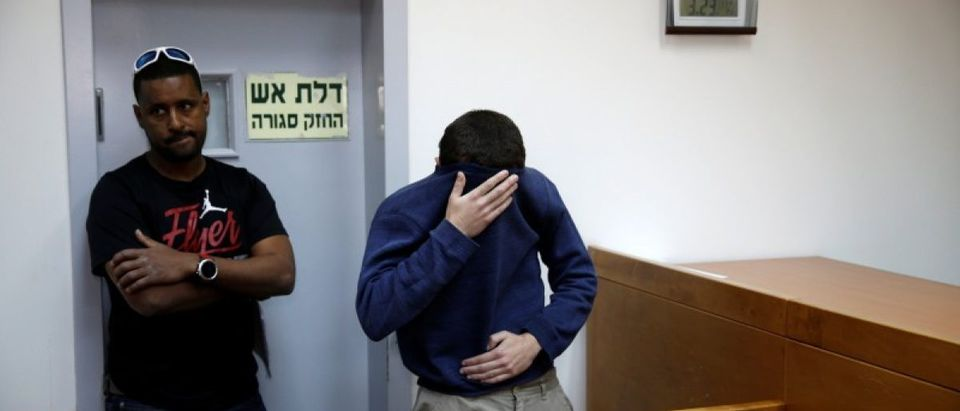 U.S.-Israeli teen arrested in Israel on suspicion of making bomb threats against Jewish community centres in the United States, Australia and New Zealand over the past three month, is seen at a remand hearing at Magistrate's Court in Rishon Lezion, Israel