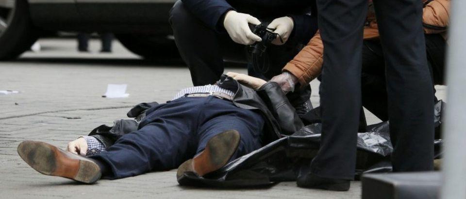 Investigators inspect body of former lawmaker of Russian State Duma Voronenkov, who was shot dead, in Kiev