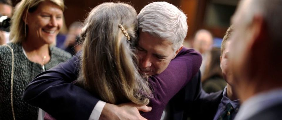 Gorsuch hugs family members during a break in the third day of his Senate Judiciary Committee confirmation hearing on Capitol Hill in Washington