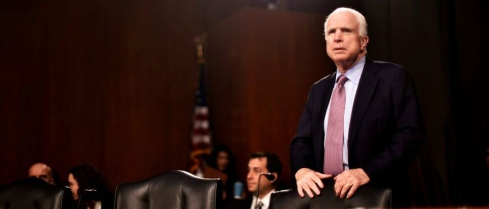 U.S. Senator John McCain (R-AZ) takes his seat before hearing testimony to the Senate Select Intelligence Committee on the nomination of former U.S. Senator Dan Coats (R-IN) to be Director of National Intelligence in Washington