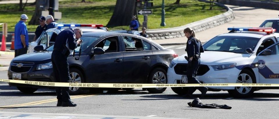 Capitol Hill police inspect a car whose driver struck a Capitol Police cruiser and then tried to run over officers, near the U.S. Capitol in Washington
