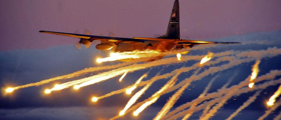 A C-130 from the Niagara Falls Air Reserve Station launches flares over Lake Ontario during a training exercise August 10, 2011, Niagara Falls, NY. Flares can be launched from an aircraft as a defensive measure against hostile forces. (U.S. Air Force photo by Staff Sgt. Joseph McKee)