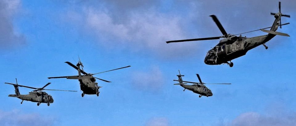 Four UH-60 Black Hawk helicopters provide air support for Soldiers conducting an air assault exercise as part of the Full Spectrum Training Event in Hohenfels, Germany, Oct. 14, 2011. The UH-60 crews are assigned to the 12th Combat Aviation Brigade-Europe. U.S. Army photo by Richard Bumgardner