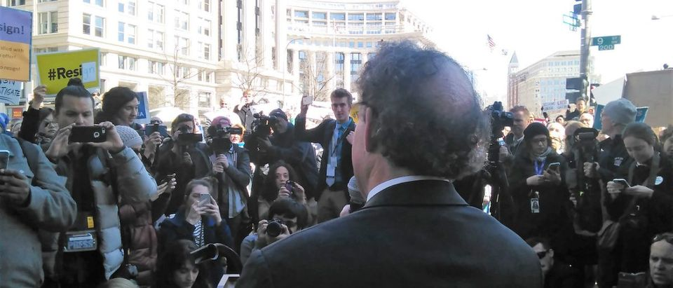 Democratic Rep. Jamie Raskin speaks to protesters outside the Dept. of Justice Thusday