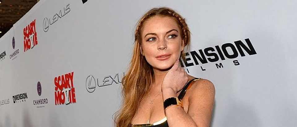 "Actress Lindsay Lohan arrives for the premiere of Dimension Films' ""Scary Movie 5"" at ArcLight Cinemas Cinerama Dome on April 11, 2013 in Hollywood, California. (Photo by Michael Buckner/Getty Images)"