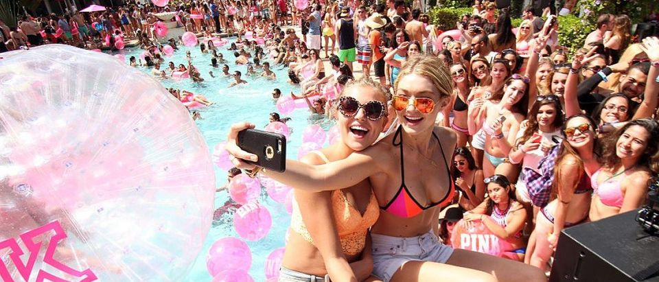 MIAMI BEACH, FL - MARCH 14: (L-R) Victoria's Secret PINK models Rachel Hilbert and Gigi Hadid attend the Ultimate Spring Break Bash hosted by Victoria's Secret PINK Nation at Surfcomber Miami, South Beach on March 14, 2015 in Miami Beach, Florida. (Photo by John Parra/Getty Images for Victoria's Secret)