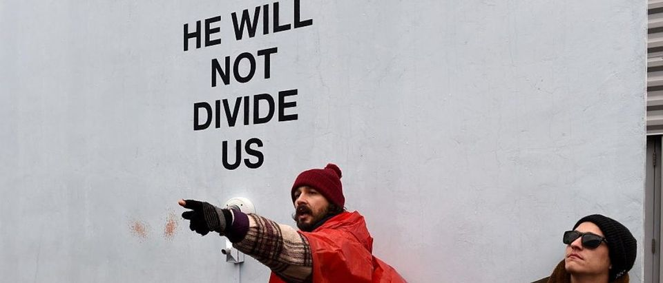 Shia LaBeouf during his He Will Not Divide Us livestream outside the Museum of the Moving Image in Astoria, in the Queens borough of New York January 24, 2017 as a protest against President Donald Trump. (Photo credit: TIMOTHY A. CLARY/AFP/Getty Images)