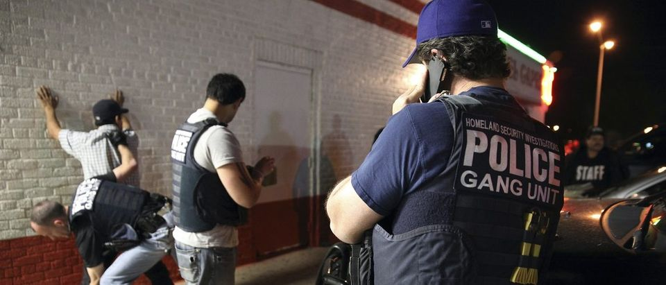 Federal agents with ICE detain a man during Project Southbound sweep for suspected gang members, in Dallas, Texas