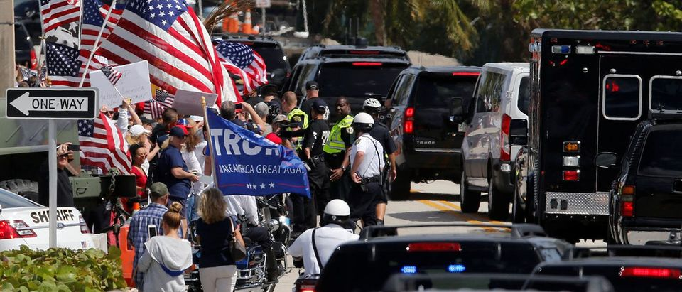 U.S. President Donald Trump's motorcade stops momentarily alongside a group of supporters as he returns to the Mar-a-Lago Club in Palm Beach