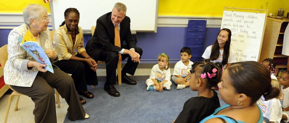 New York City Chancellor Carmen Farina reads a book to students during the first day of school at PS 59 in Staten Island, New York,