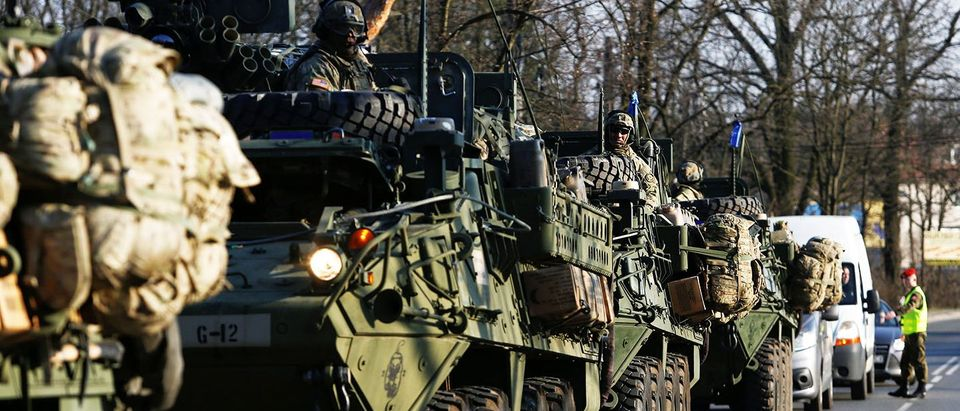 A convoy of U.S. troops, a part of NATO's reinforcement of its eastern flank, who are on their way from Germany to Orzysz in northeast Poland, drive through Sulejowek towards a military base in Wesola