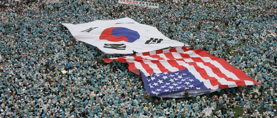 Christians and conservative rightists carry a South Korea flag and a U.S. flag above their heads in Seoul