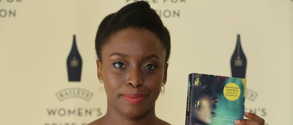 """Author Chimamanda Ngozi Adichie poses with her novel """"Americanah"""" ahead of the 2014 Bailey's Women's Prize for Fiction in London June 4, 2014. Irish author Eimear McBride won the 2014 Bailey's Women's Prize for Fiction on Wednesday for her first novel, """"A Girl is a Half-Formed Thing"""", which took her 10 years to get published. REUTERS/Neil Hall"""
