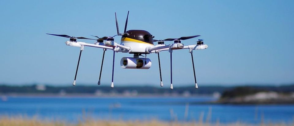 A drone, made by CyPhy Works, carries a UPS package on Children's Island off the coast of Beverly