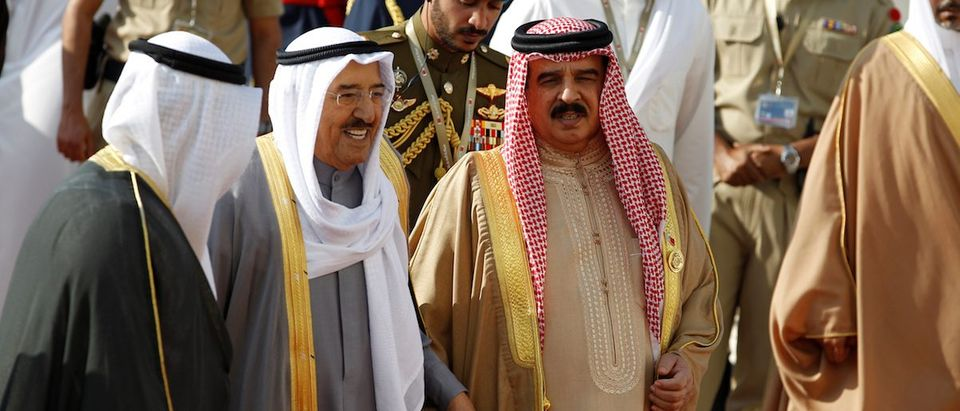 Emir of Kuwait, Sabah Al-Ahmad Al-Jaber Al-Sabah is received by Bahrain's King Hamad bin Isa Al Khalifa upon his arrival at Sakhir VIP airport to attend the GCC 37th Summit