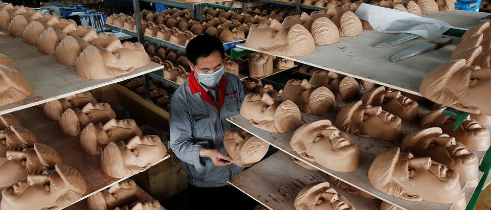 The Wider Image: U.S. election: manufacturing the masks