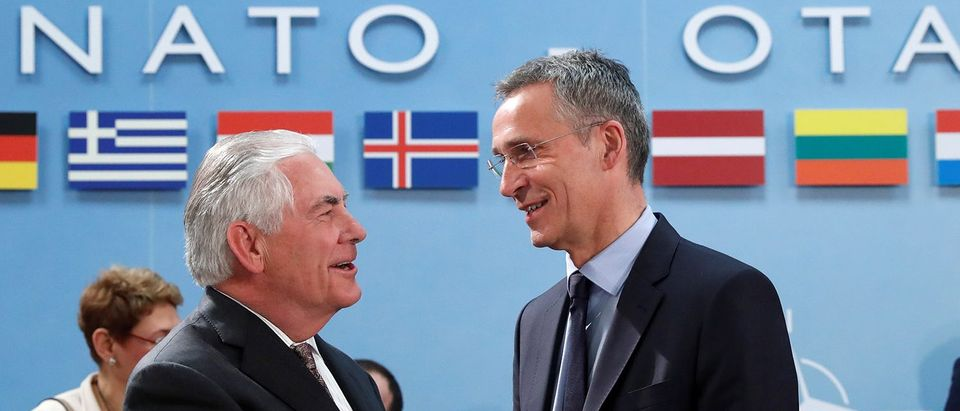U.S. Secretary of State Tillerson shakes hands with NATO Secretary General Stoltenberg during a NATO foreign ministers meeting at the Alliance's headquarters in Brussels