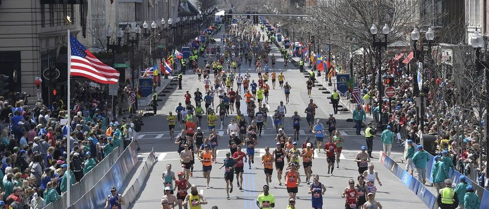 Runners approach the finish line during the 120th running of the Boston Marathon in Boston, Massachusetts