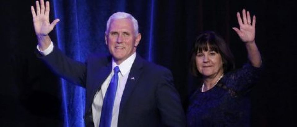 Mike Pence and his wife Karen Pence arrive. REUTERS/Carlo Allegri