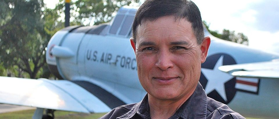 Picture of Michael Madrid standing in front of an Air Force plane. Photo Credit: First Liberty.