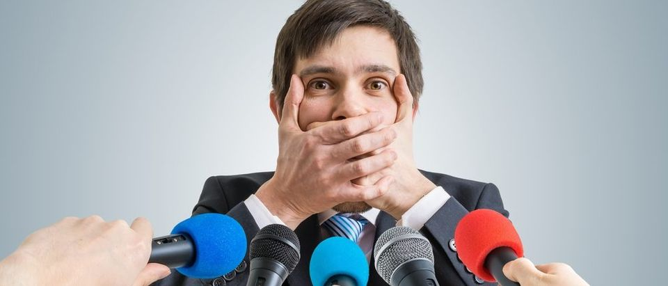 Politician Covers Mouth