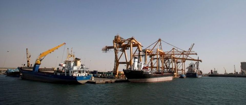 FILE PHOTO: Ships are docked next to giant cranes, damaged by Saudi-led air strikes, at a container terminal at the Red Sea port of Hodeidah