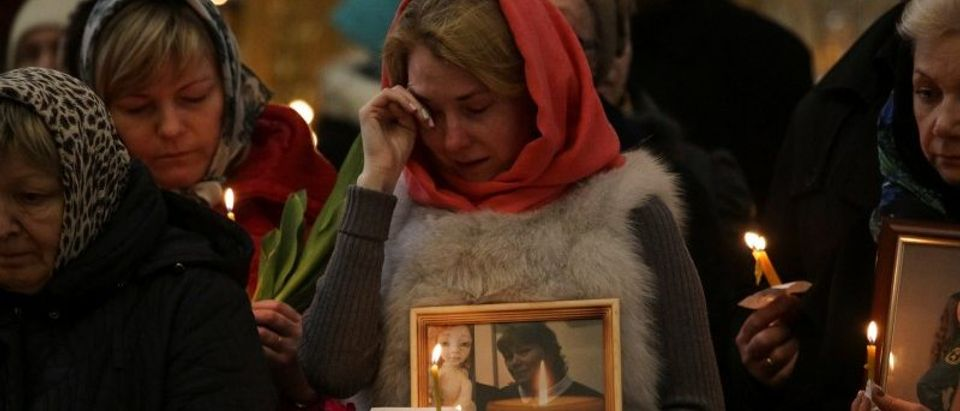 Relatives of victims of the Monday's metro bombing attend a memorial service at the Trinity Cathedral in St.Petersburg