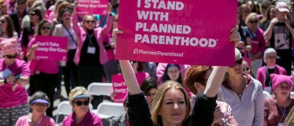 Demonstrators hold up placards during a Planned Parenthood rally outside the State Capitol in Austin, Texas, April 5, 2017. REUTERS/Ilana Panich-Linsman