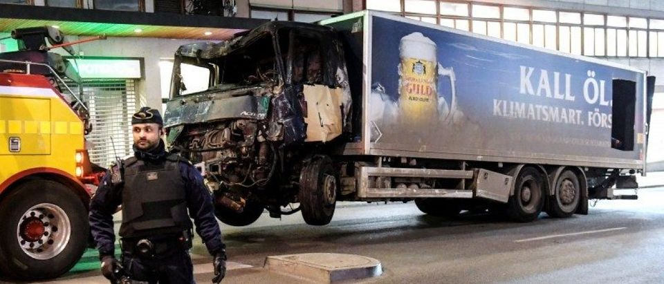 Tow trucks pull away the beer truck that crashed into the department store Ahlens after plowing down the Drottninggatan Street in central Stockholm