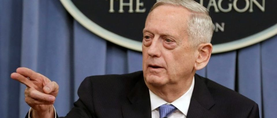 Mattis gestures to the media at the Pentagon in Washington