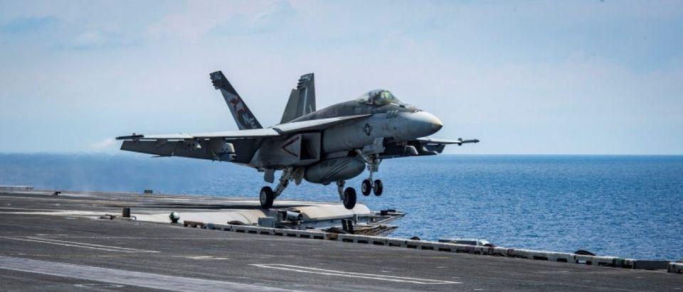"An F/A-18E Super Hornet from the ""Kestrels"" of Strike Fighter Squadron (VFA) 137 takes off from the aircraft carrier USS Carl Vinson (CVN 70) transiting the South China Sea"