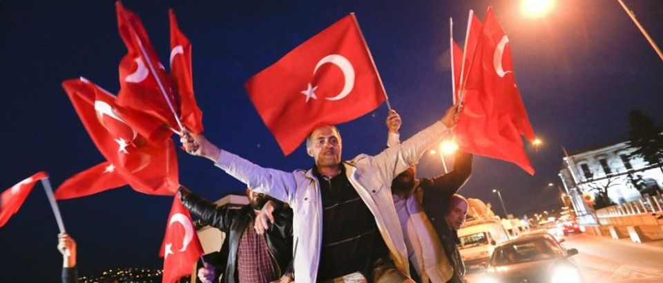 Supporters of Turkish President Tayyip Erdogan wave national flags in Istanbul,