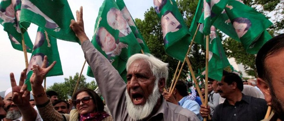 Supporters of Pakistan's Prime Minister Nawaz Sharif gesture following the Supreme Court decision, in Islamabad